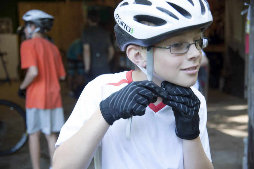Putting on bike helmet