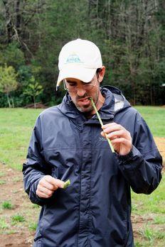 Farmer Phil eating fresh asparagus