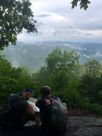 Jace and Eli consult a map for a Blue Ridge Expeditions scout week hike